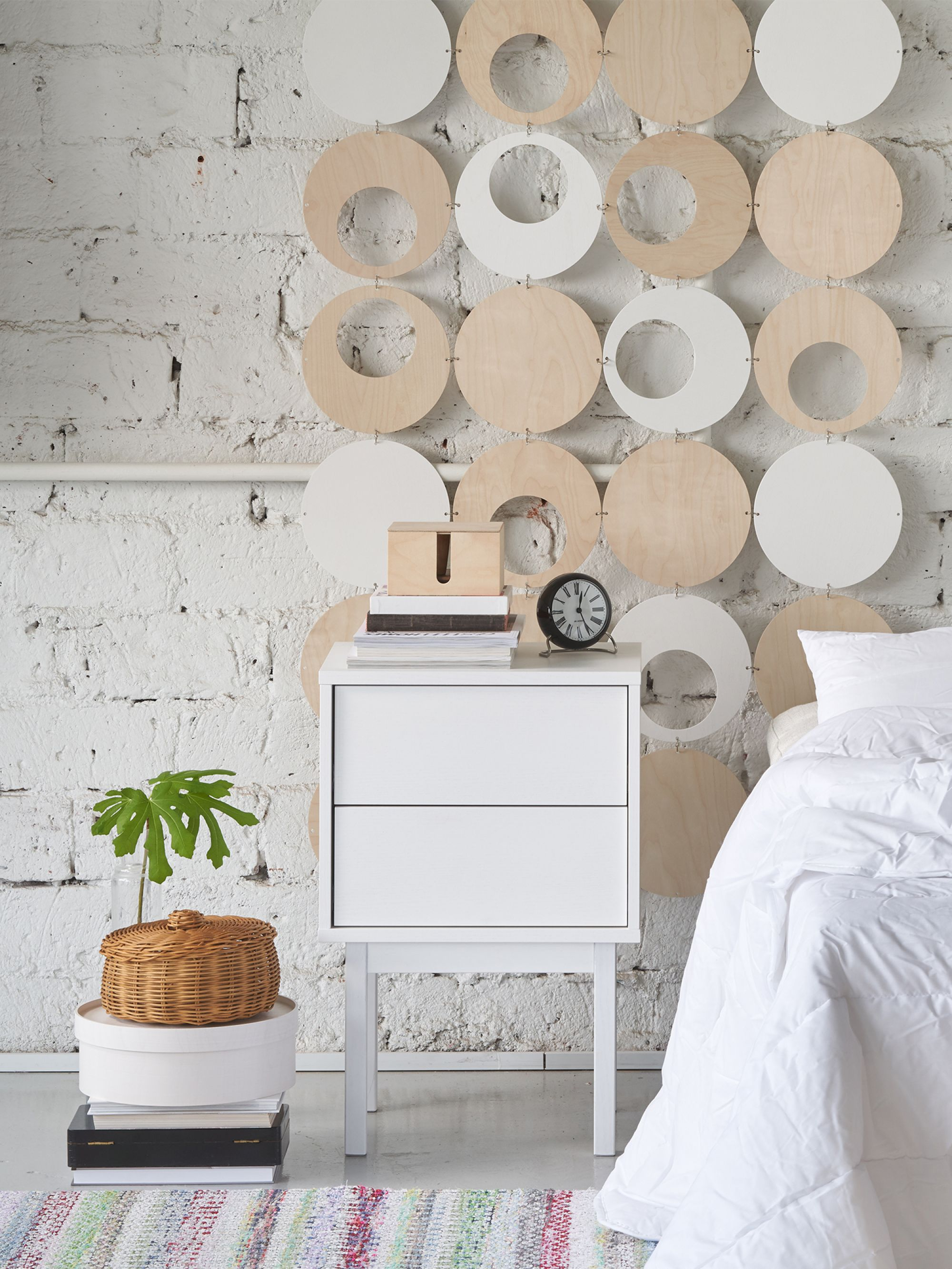 White bedside table in white bedroom